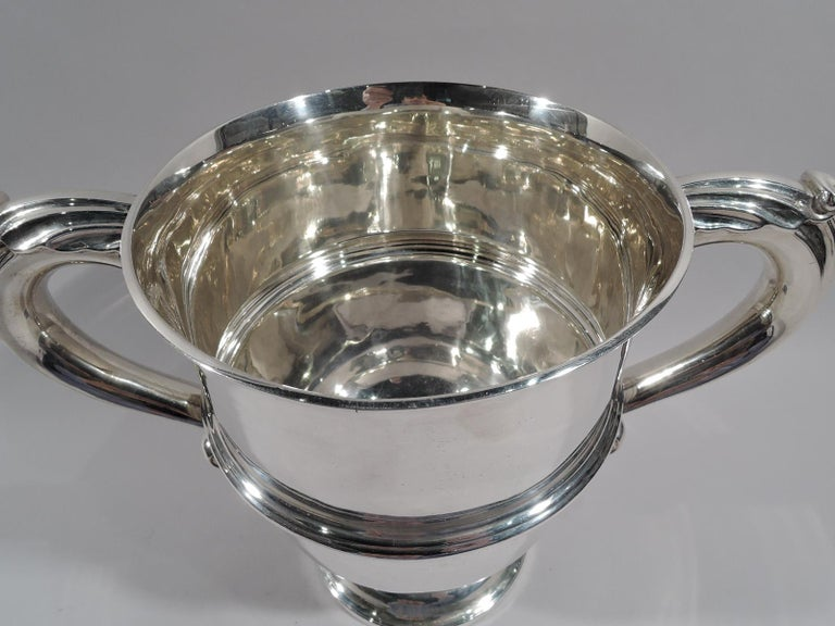 Victorian classical sterling silver urn cup. Made by Elkington in Birmingham in 1896. Girdled with leaf-capped s-scroll side handles and stepped and round foot. Capacious and traditional with lots of room for engraving. Fully marked. Heavy weight: