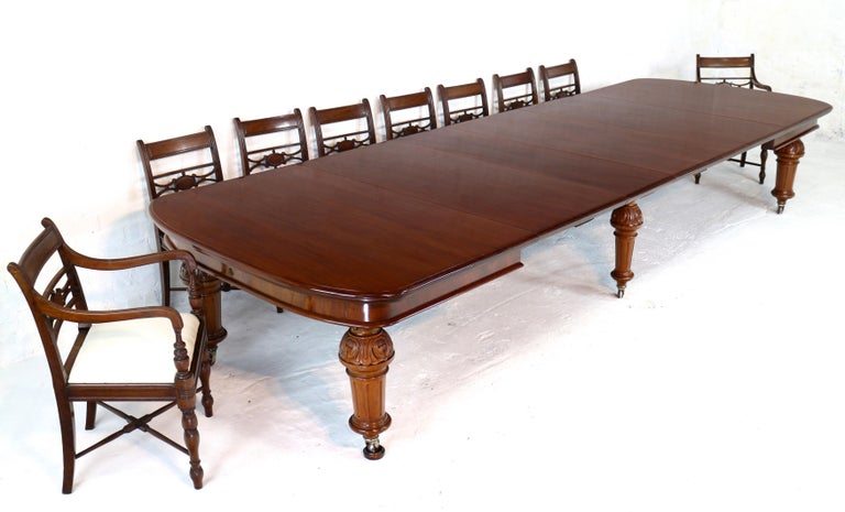 A super quality antique Victorian mahogany wind-out extending dining table with four additional leaves and standing on six substantial legs. This large 4ft9 wide table smoothly extends from 6ft to 13ft 8in by means of a double 'screw expander'