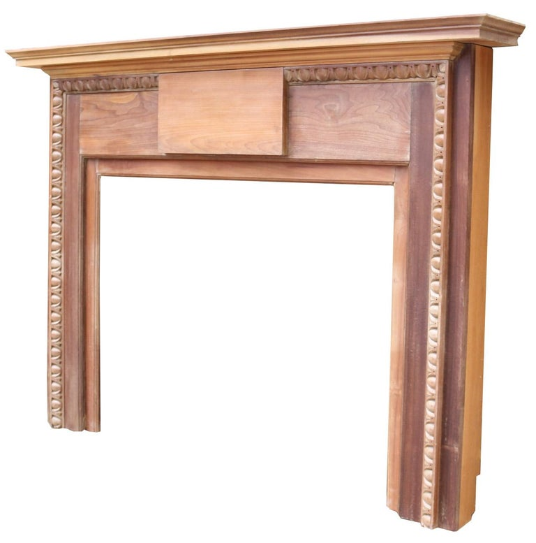 About  This English fire surround features hand carved egg and dart moulding. By repute, from Mickleham hall, Dorking.  Condition report:  In good condition for its age. side returns have been replaced in oak when it was last fitted. Believed
