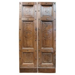 Antique Entrance Door in Walnut with Carved Decorations, 19th Century, Italy
