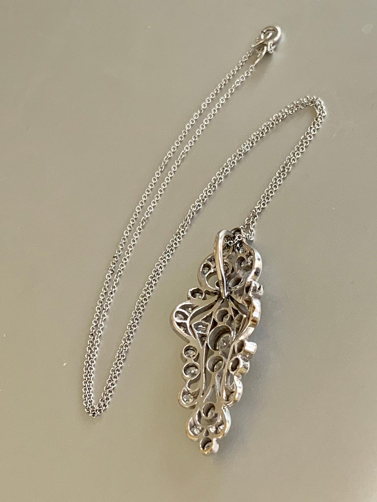 What an amazing pendant.  It features European cut Diamonds totaling 1.5ctw.  Grades are estimated average of SI-H.   The pendant is Platinum and the chain is 14 karat white Gold.  The chain is 15