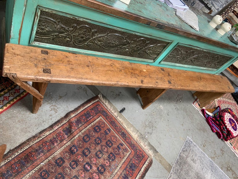 This European antique bench shows natural wood grain and signs of fine aging. This handcrafted piece has gorgeous patina to wood. What also makes the bench so special is it's unique size measuring at 107