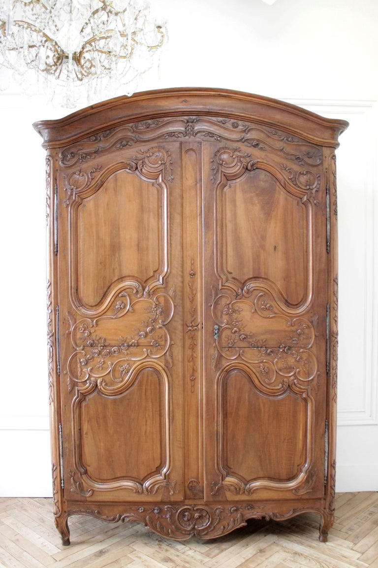 Antique European French provincial carved roses armoire cabinet Beautiful carved walnut armoire with large carved rose swags on each door. Working locking key, the door needs to be locked to keep closed. Crown and the doors are the only parts that
