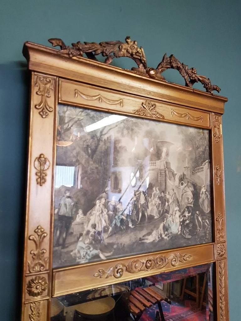 Antique faceted mirror in gilded neoclassical plaster frame with old print behind glass, this is in a reasonable condition with some small defects around it and there is again in the mirror. Originating from the end of the 19th century and beginning