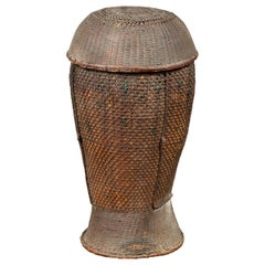 Antique Farmer's Grain Basket with Iridescent Motifs and Weathered Appearance