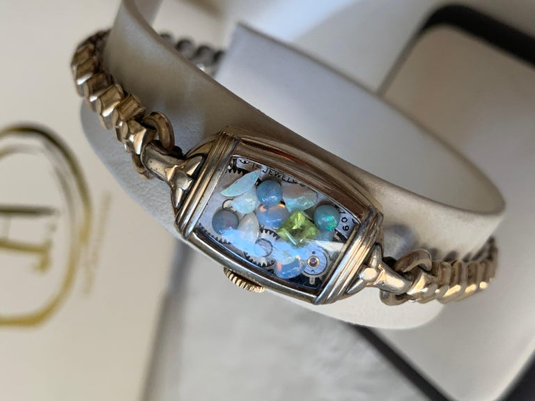The Fairydust band is a non-functioning antique watch  a symbol, a talisman, to hold the intention of staying present, neither dwelling in the past nor looking toward the future. The fairydust inside this particular band is over 2 carats of Vintage