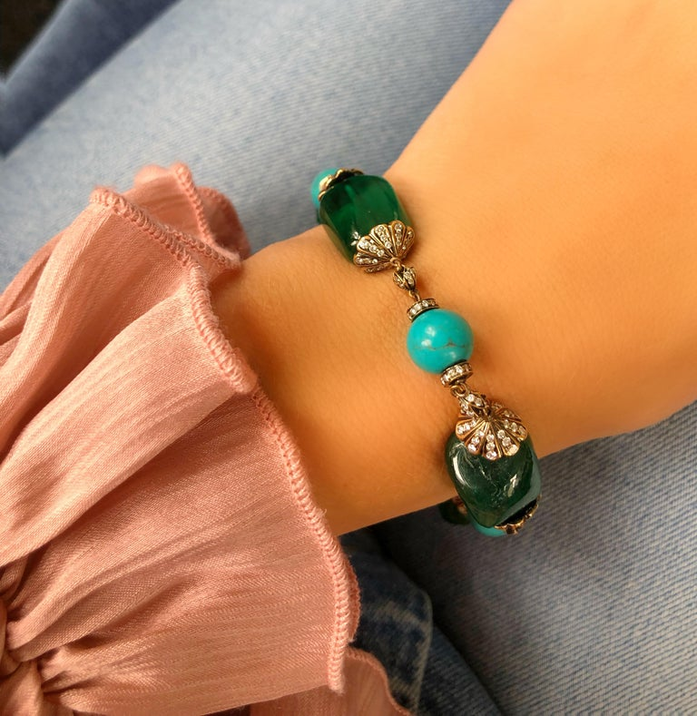 Where can you find this many huge, juicy emeralds in one bracelet for this price?! Our bead bracelet features four large emerald beads (likely of Brazilian origin) weighing a total of at least 70 carats, alternating with 3 vintage Persian turquoise