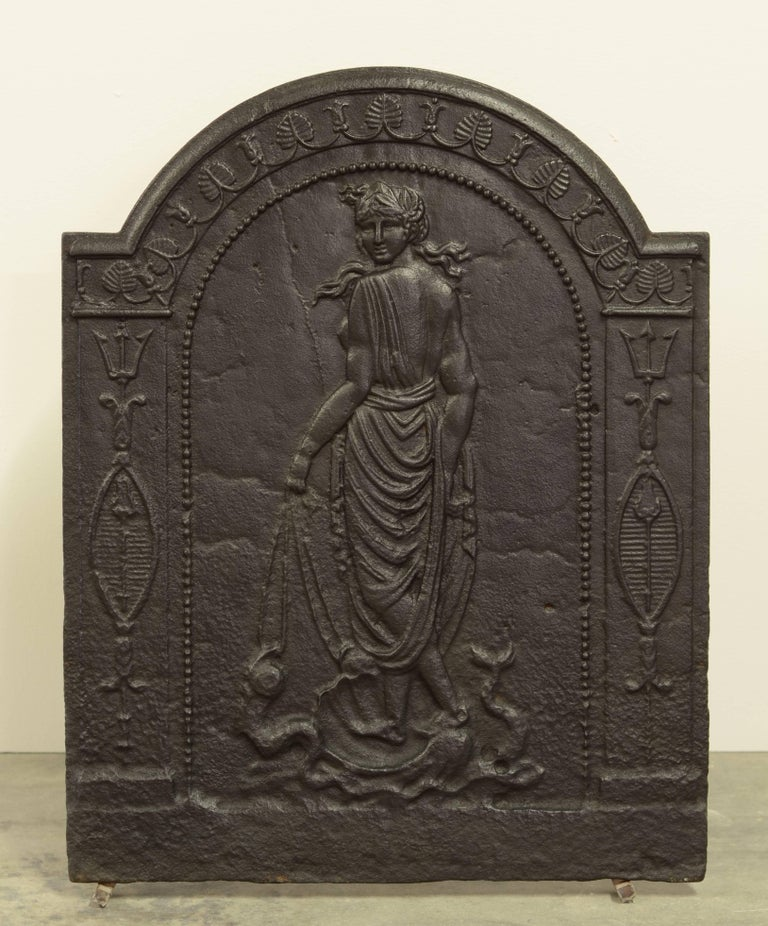 Beautifully detailed cast iron fireback showing Venus the Goddess of love, beauty and fertility.  This fireback is in great condition, to be used an a fireplace or as backsplash. Can be supplied with stand.
