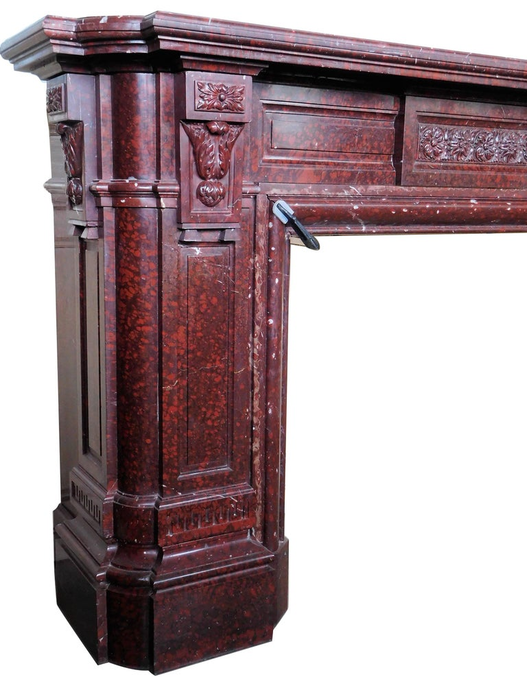 This impressive fireplace was made circa 1850 from the highly-valued Griotte Rouge marble.