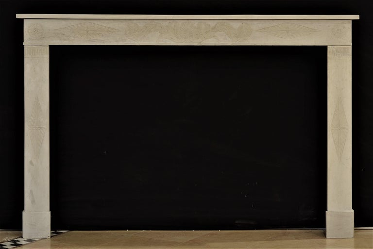 Antique fireplace mantel 19th century limestone Louis XVI from France Finely carved Louis XVI in very soft toned and warm grayish limestone from France . Beautifully decorated and finely carved frieze, central foliage flanked by diamond