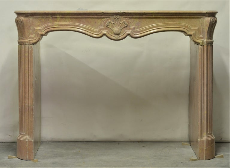 French antique Louis XV fireplace mantel, 18th Century.  This great looking mantel is made from