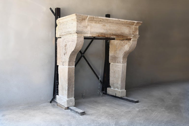 This antique French limestone fireplace comes from the Beaune region and is in the style of Louis XIII from the 18th century. A beautiful fireplace with nice dimensions and warm color nuance! We have found this antique fireplace in an old French