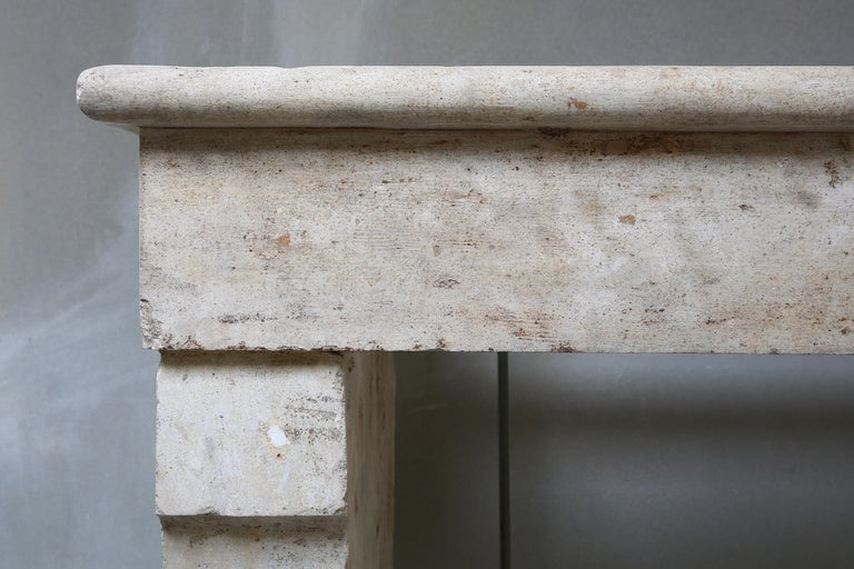 Antique Fireplace of French Limestone, 19th Century, Campagnarde Style In Good Condition For Sale In Made, NL