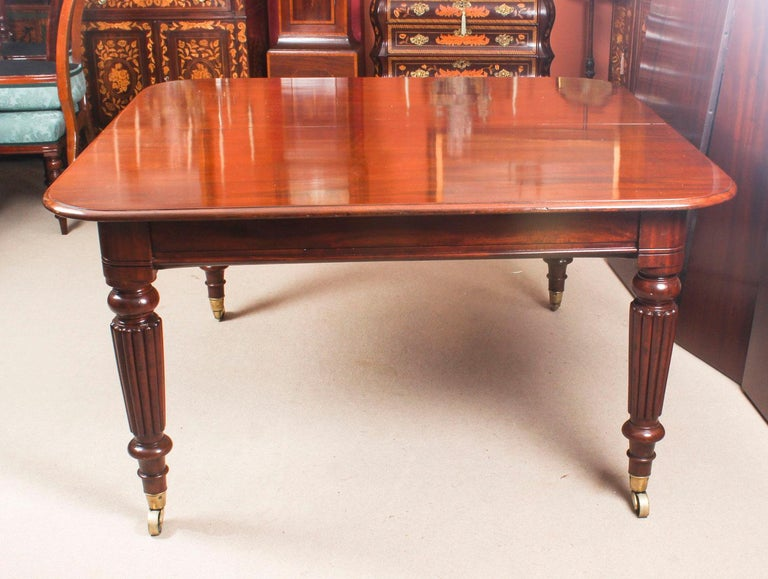 Antique Flame Mahogany Extending Dining Table 19th Century and 10 Chairs For Sale 5