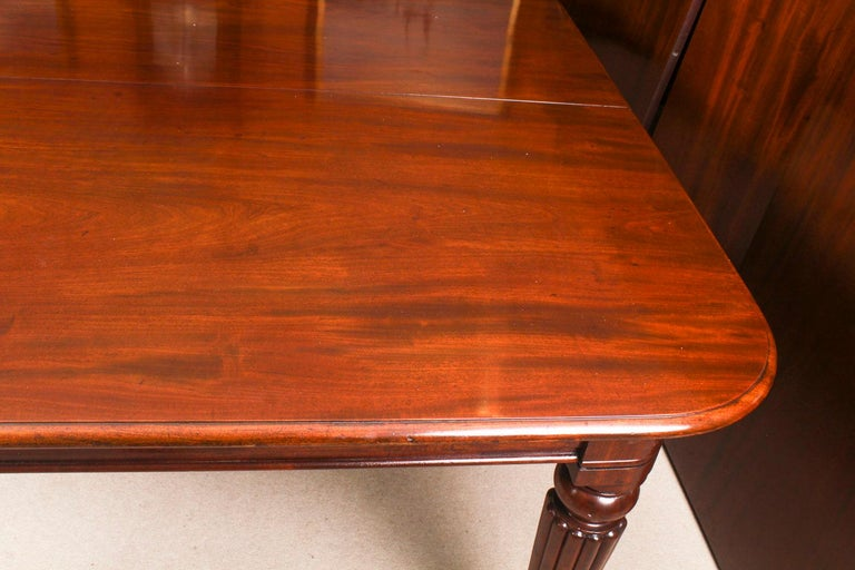 Antique Flame Mahogany Extending Dining Table 19th Century and 10 Chairs For Sale 9