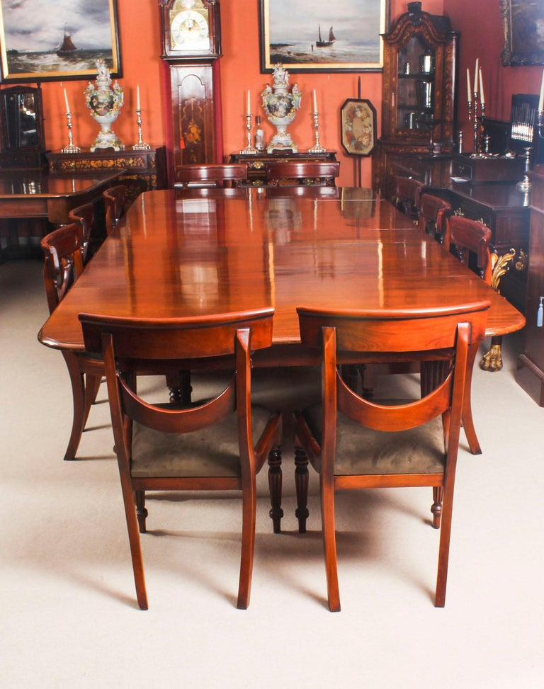 This is a beautiful dining set comprising an antique early Victorian flame mahogany extending dining table, circa 1840 in date and a set of ten bespoke Swag Back dining chairs.  This amazing table can sit ten people in comfort and at a stretch up