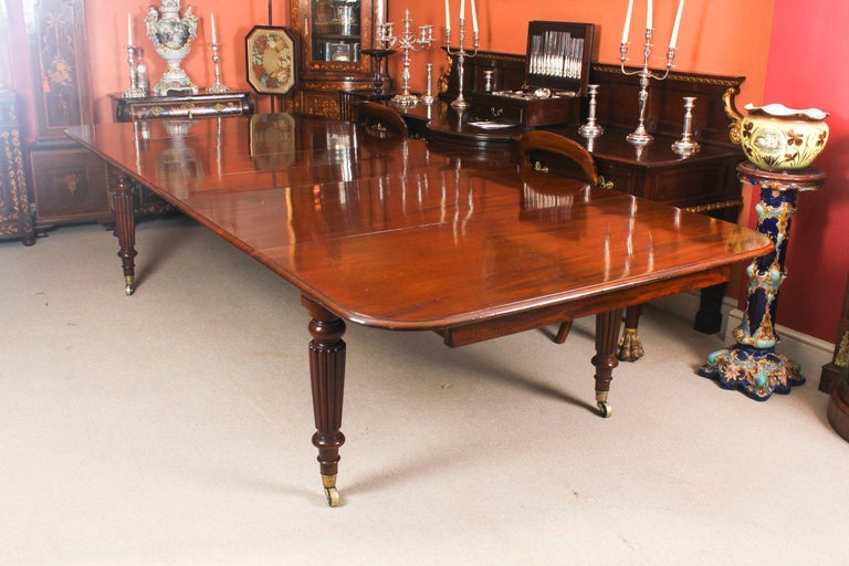 English Antique Flame Mahogany Extending Dining Table 19th Century and 10 Chairs For Sale
