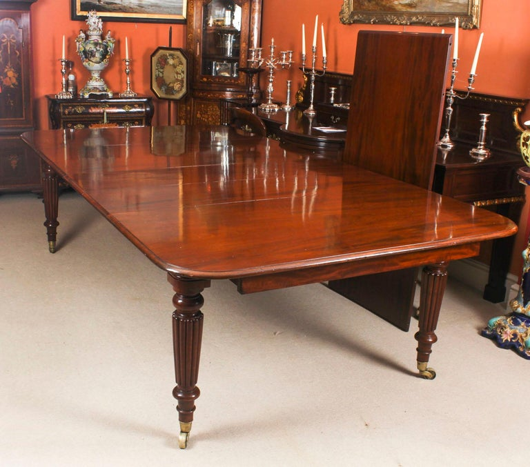 Antique Flame Mahogany Extending Dining Table 19th Century and 10 Chairs For Sale 1