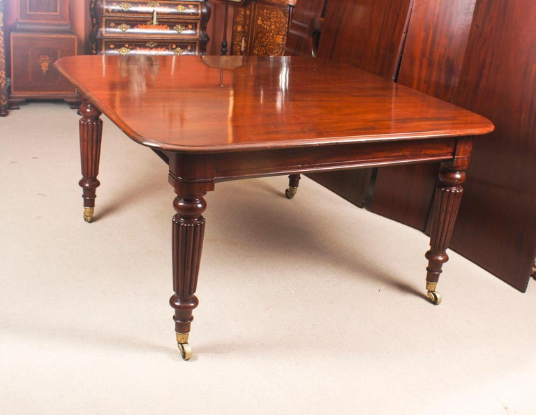 Antique Flame Mahogany Extending Dining Table 19th Century and 10 Chairs For Sale 3