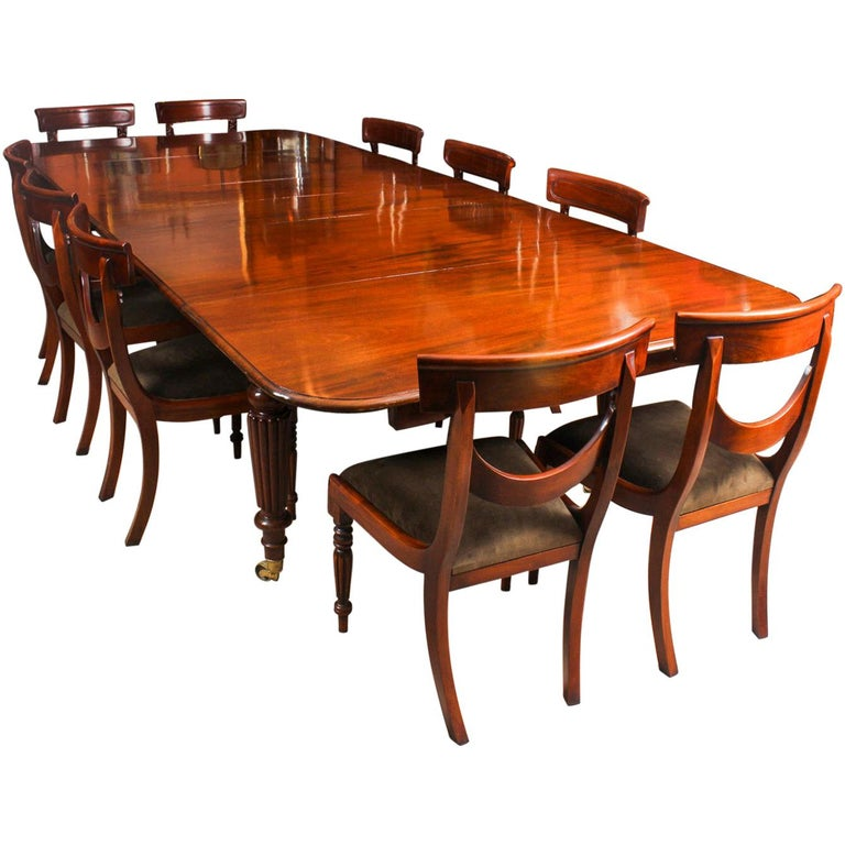 Antique Flame Mahogany Extending Dining Table 19th Century and 10 Chairs For Sale