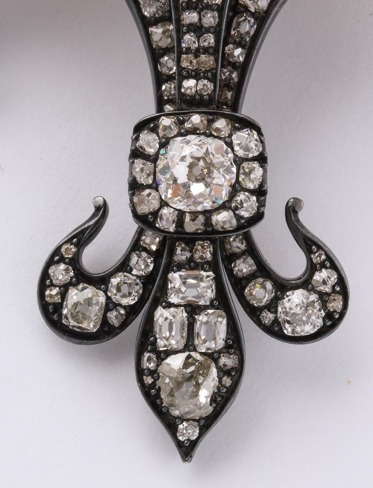 Antique Fleur de Lis Diamond Gold pendant brooch in 14k gold set with over 124 diamonds.  Material: 14k gold, 31 gm  Stones:  Over 124 diamonds, 213 carat old mine cut h/vvs  Measurements: 3 1/4 inch by 2 inch wide, 3/16 inch deep