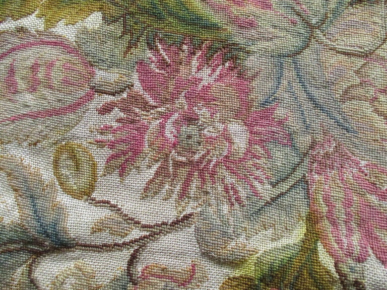 Antique floral tapestry fragment Textile design with a floral motif in shades of yellow, orange, green, tan, taupe and brown. Needs backing and restoration, ideal for reupholstering. Size: 26