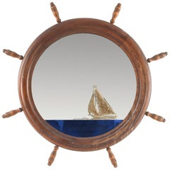 Antique Folk Art Reverse-Gilded Verre Églomisé Mirror with Ship's Helm Frame