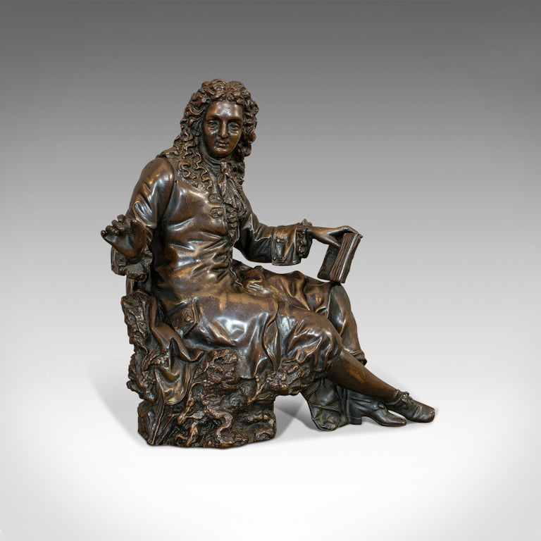 This is an antique Jean de la Fontaine figure. A French, bronze statue after Ernest Rancoulet, dating to the early 20th century, circa 1920.  A bronze seated figure of noted fabulist Jean de la Fontaine Displays a desirable aged patina Bronze