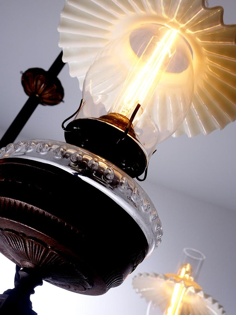 This is a beautiful early four-light oil lamp. The type often used in public spaces in the mid-19th century. Its simple yet impressive with a spread that is almost 4 foot. These were pre-electricity so it takes some work to run wires tastefully. The