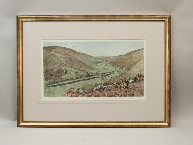 Equestrian, Devon & Somerset Hunt by Cecil Aldin. A large framed hunting color lithograph by Cecil Aldin, The Devon and Somerset - Crossing Badgworthy Water, Exmoor, in the 1920s. The picture is signed in pencil in the margin by the artist and is