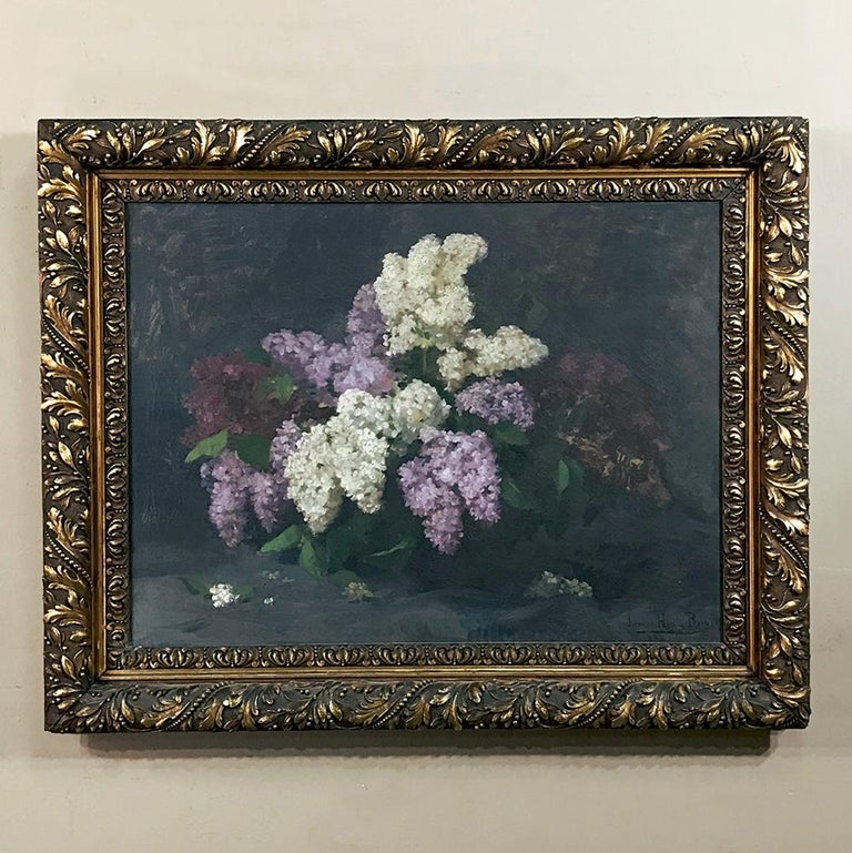 Antique framed oil painting on canvas by Louise Hiertz-Beer, dated 1923 is a splendid still life, wherein the artist used post-impressionistic techniques to create a dark gray background which contrasts perfectly with the subtle jewel tones of the