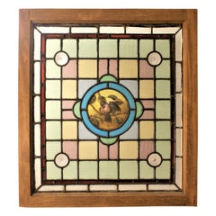 Antique Framed Victorian Stained Glass Window with a Hand Painted Bird Medallion