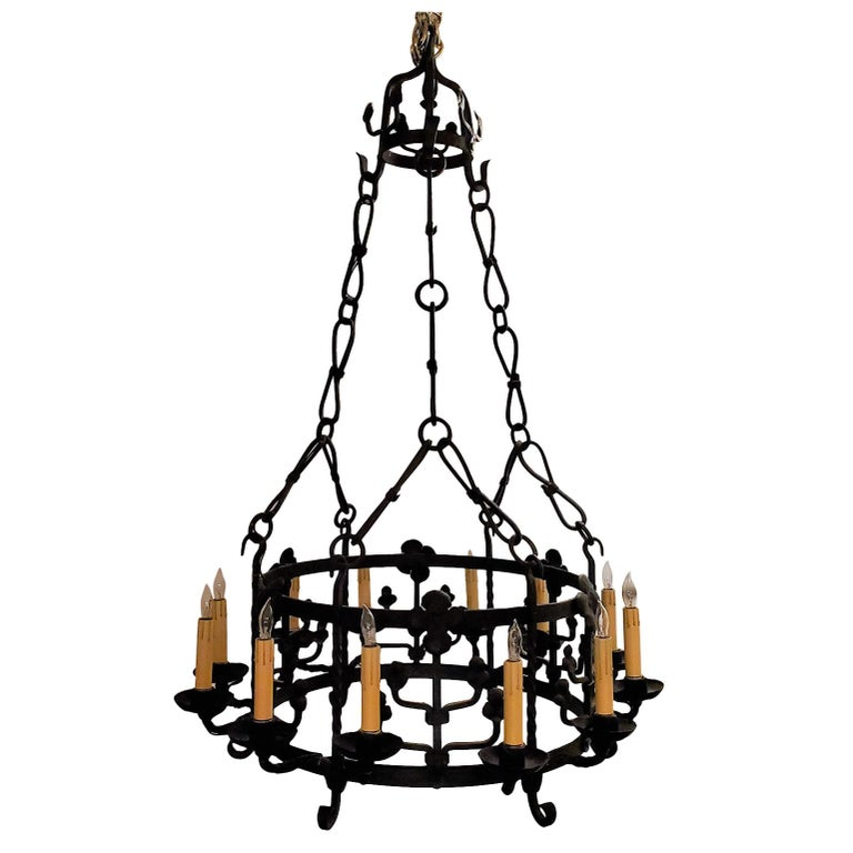 Antique French 12-Light Wrought Iron Chandelier For Sale