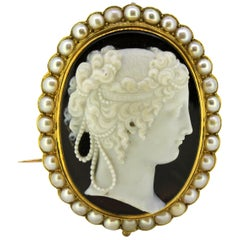 Antique French 18 Karat Gold Brooch with Cameo Carving on Onyx and Pearls