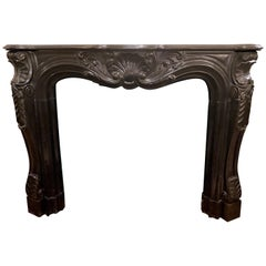 Antique French 19th Century Carved Black Marble Mantel