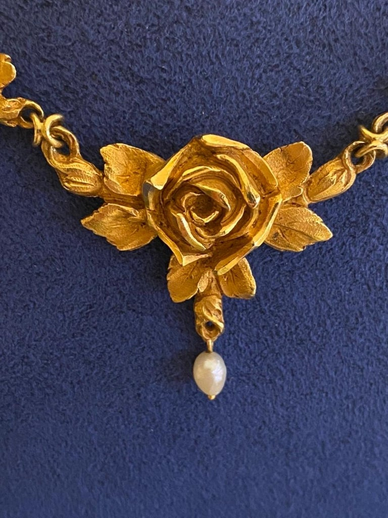 Antique French Art Nouveau Gold Necklace  Very beautiful necklace, made in France circa 1900, art nouveau era. Made in yellow gold 18k and pearls. It has presence, the flower patterns are big, it is rare piece. The lengh is 41.5 cm, it is