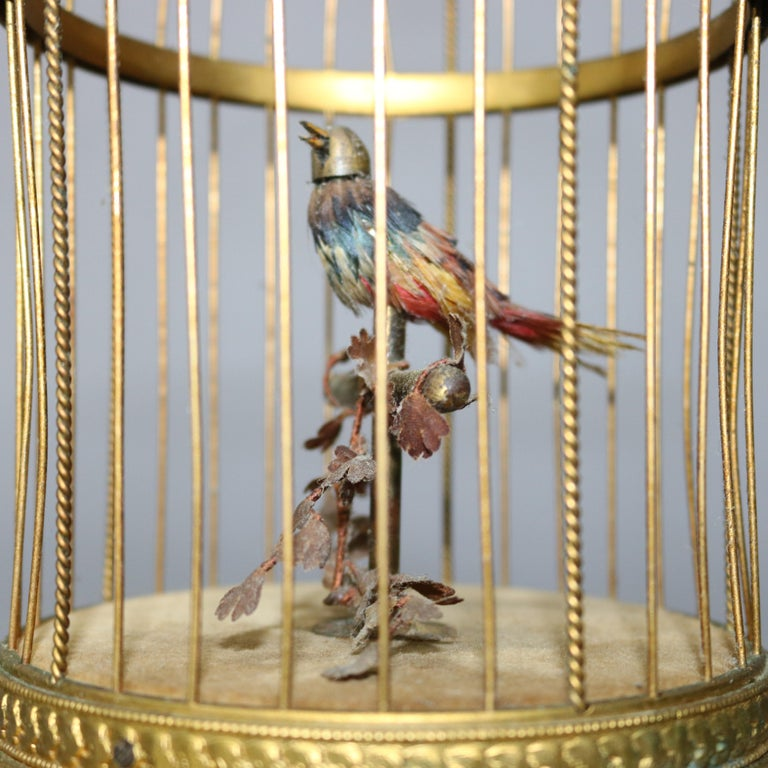 An antique French automaton music box offers singing bird seated on foliate branch in brass cage, circa 1880  ***DELIVERY NOTICE – Due to COVID-19 we are employing NO-CONTACT PRACTICES in the transfer of purchased items.  Additionally, for those who