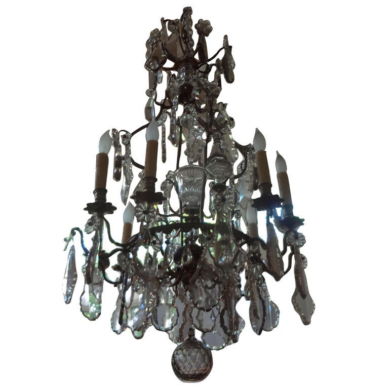 Unusual antique French Louis XVI style eight-light crystal chandelier, circa 1920. This stunning large antique French crystal chandelier, possibly Baccarat, has been newly wired and can be hung from a chain for required height. Would look beautiful