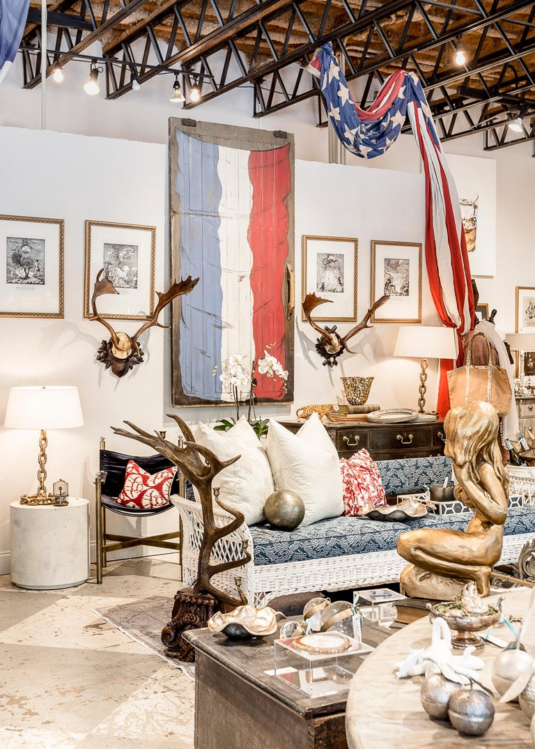 Antique sliding barn door from the South of France dating to the late 1800s with painted motif of the French flag. Distressed oak with grey finish and weathered handle, this piece is beautifully displayed mounted to a wall as large-scale artwork or