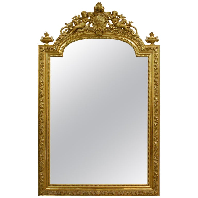 Antique French Baroque Giltwood Mirror with Putti or Cherubs in Crest For Sale