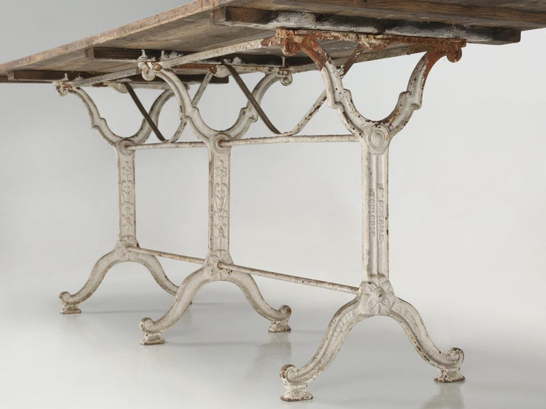Antique French Bistro Table with Cast iron Base, Old Paint and Rustic Wood Top For Sale 4