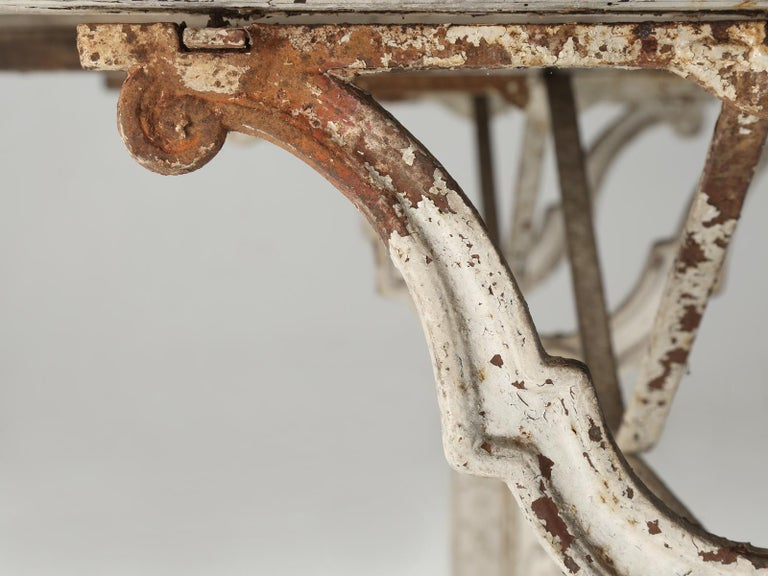 Antique French Bistro Table with Cast iron Base, Old Paint and Rustic Wood Top For Sale 6