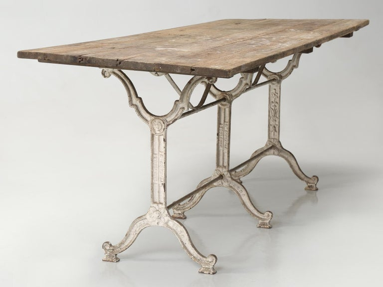 Country Antique French Bistro Table with Cast iron Base, Old Paint and Rustic Wood Top For Sale