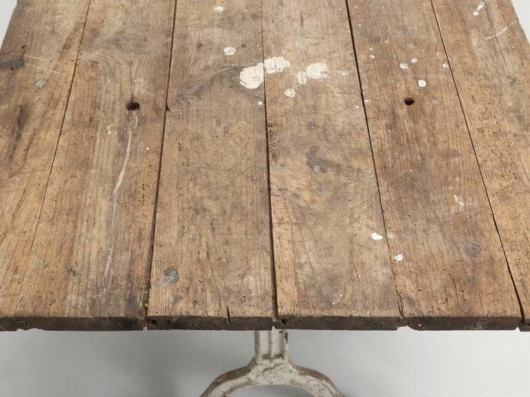 Iron Antique French Bistro Table with Cast iron Base, Old Paint and Rustic Wood Top For Sale