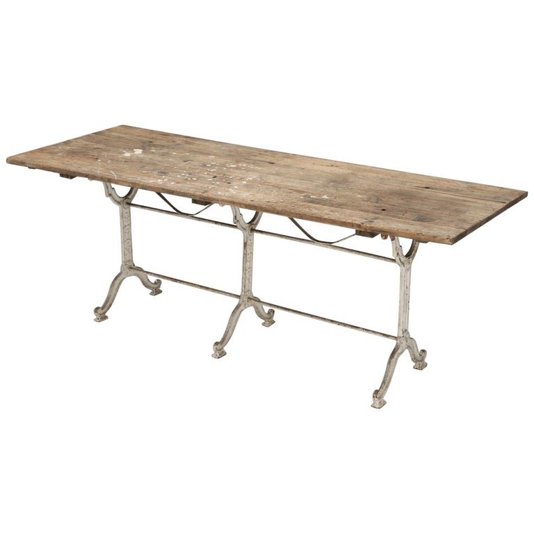 Antique French Bistro Table with Cast iron Base, Old Paint and Rustic Wood Top For Sale