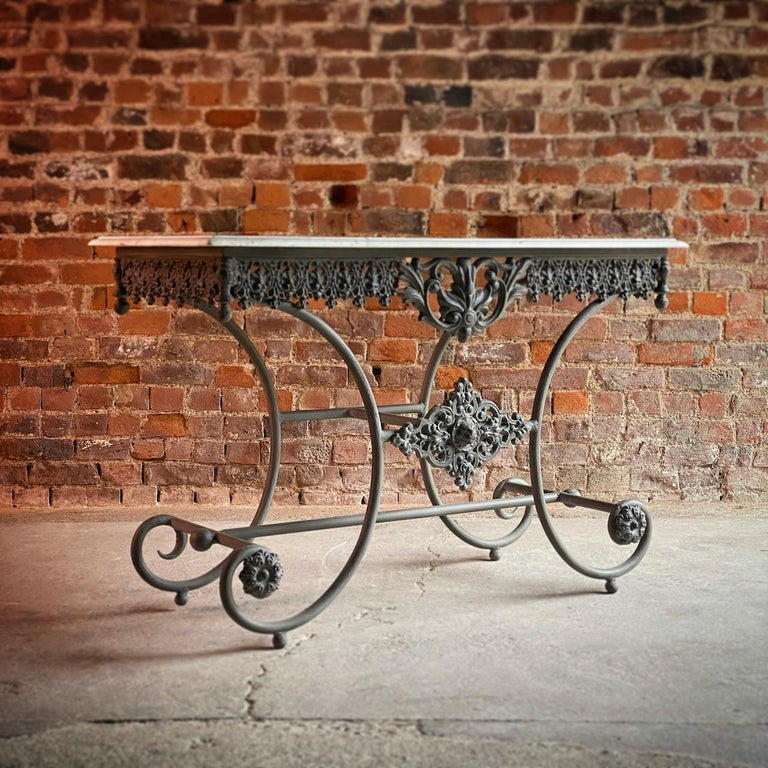 Antique French Boulangerie pastry table France circa 1890   Magnificent and original 19th century French Boulangerie Pastry table dating to France circa 1890, the rectangular white marble top over a scrolling wrought iron base with beautiful