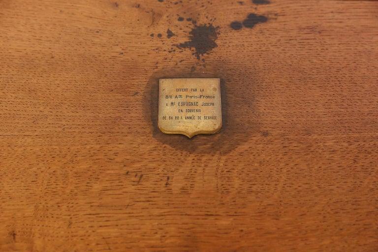 This large and sturdy antique wood box was found in southern France. The box features brass handles, a brass lock and a brass plaque on the top. The brass plaque reads: Offert Par La Ste Ame Paris-France a Mr Espagnac Joseph en Souvenir de sa 20