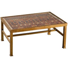 Antique French Brass Coffee Table Enclosing a Rug Under Glass, circa 1900