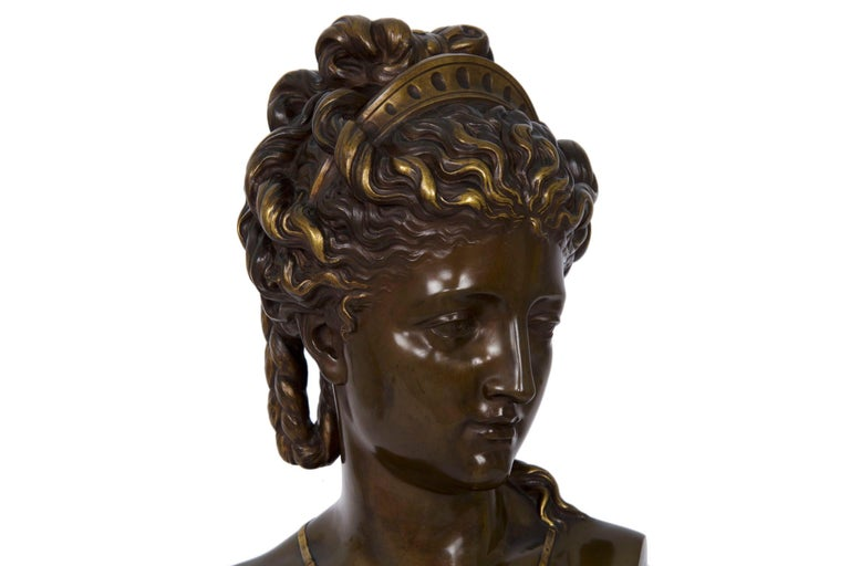 Eugene Aizelin (French, 1821-1902) bronze bust of a woman with tiara Cast by F. Barbedienne, signed in shoulder E. Aizelin 1870, signed in back F. Barbedienne Fondeurs   A very fine bronze bust of a woman with a tiara by Eugene Aizelin, the work