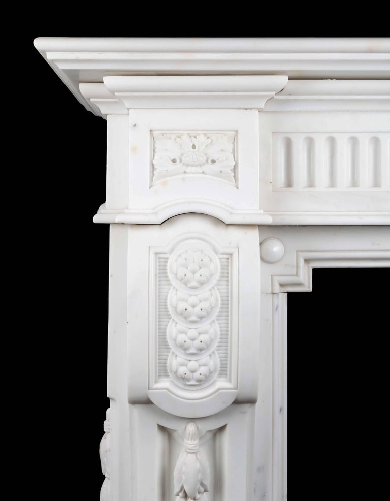 Antique French statuary Carrara marble mantelpiece of large scale and great quality. This magnificent Napoleon III style mantelpiece is beautifully carved in the purest of white statuary marble.
